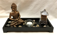 Resin Buddha candle holder with small stone and small pagoda.