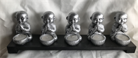 Five small monk candle holders Material: resin, wood, candle